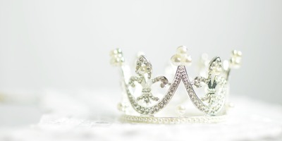 silver and pearl crown on white background