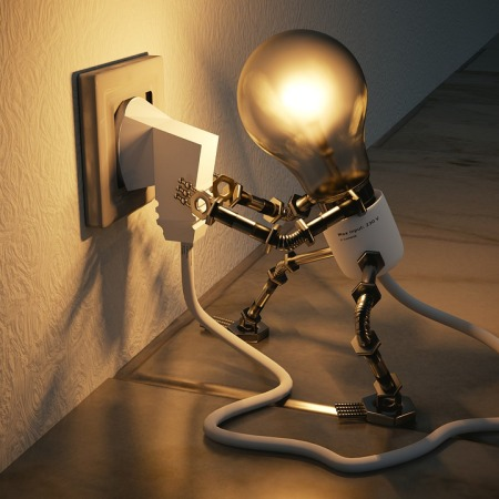 A small robot light bulb trying to unplug itself from the wall outlet