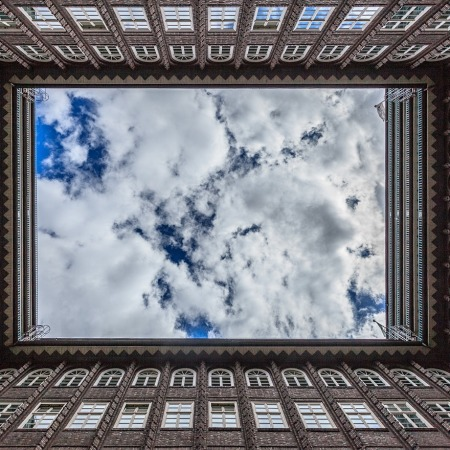 clouds through building roof