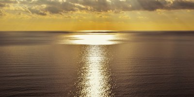 Sunlit path of light over the ocean