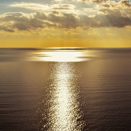 Sunlit path of light over the ocean