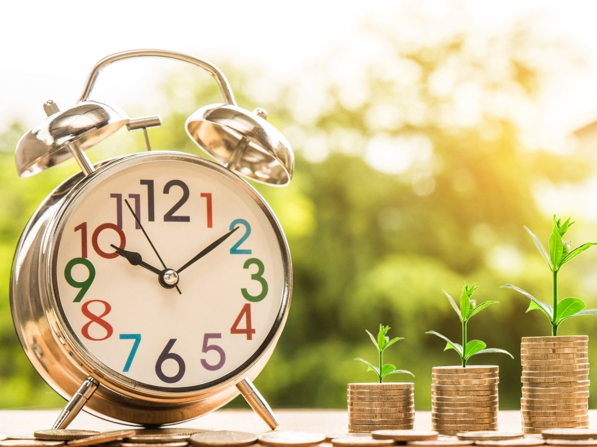 Clock shows that coins or investments grow over time