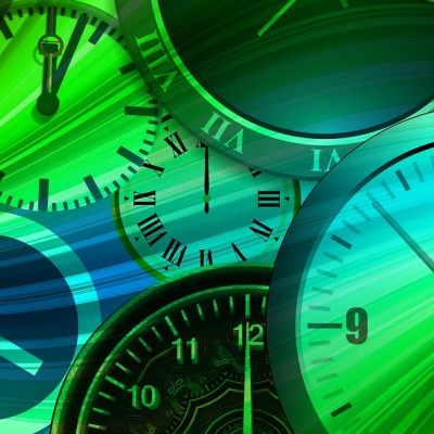 Clocks set in swirling rainbow colors depicting time, goals, success